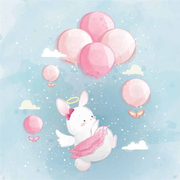 Conejito angelical volando en el cielo