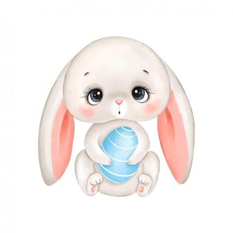 Conejito de pascua de dibujos animados lindo con un huevo aislado