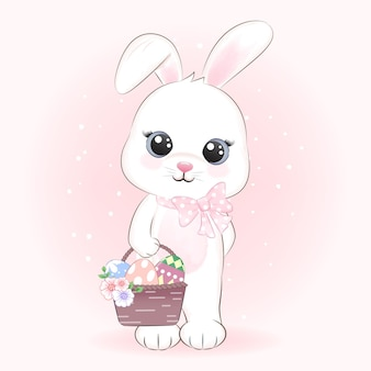 Conejito sosteniendo huevos en la canasta, concepto de día de pascua