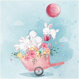 Conejitos lindos en el carrito de primavera