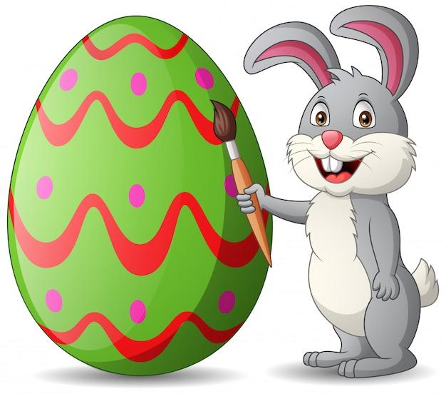 Conejo de dibujos animados es pintar huevos. ilustración