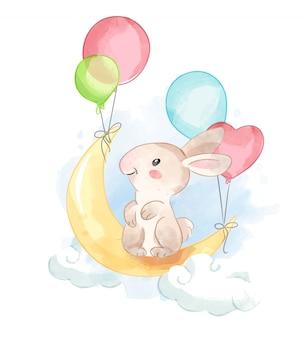 Conejo de dibujos animados en la luna con globos de colores