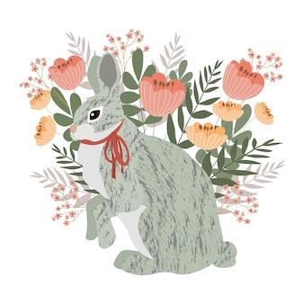 Conejo gris sobre un fondo floral.