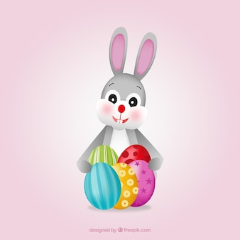 Conejo de pascua lindo con huevos