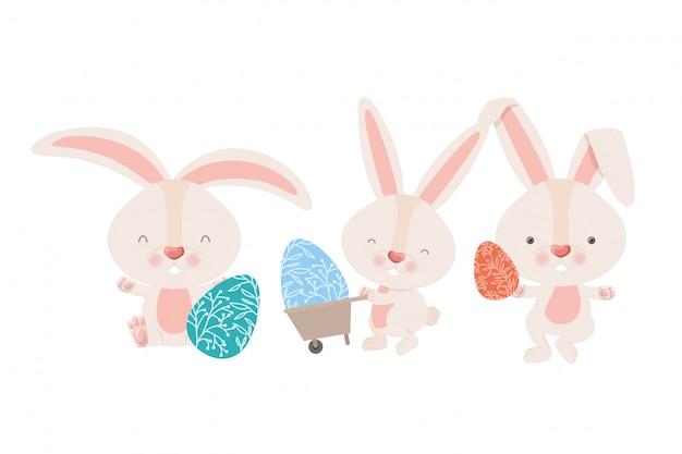 Conejos con icono de carretilla y huevo de pascua.
