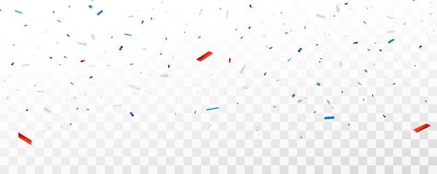 Confeti de celebración y cintas rojas y azules.