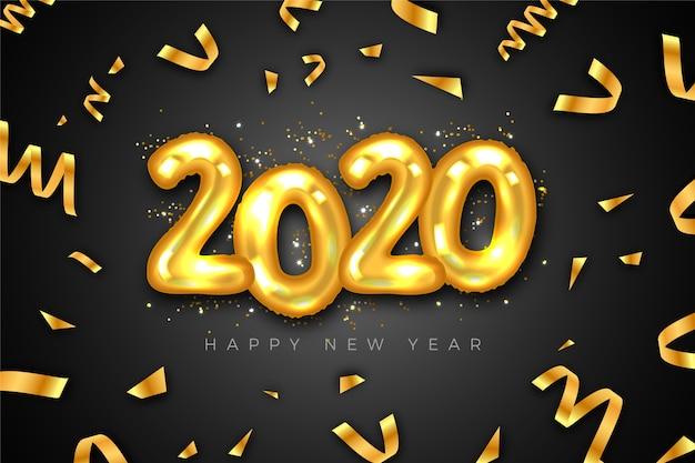 Confeti dorado y globos año nuevo 2020