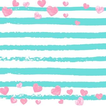 Confeti rosa brillo con corazones sobre rayas turquesas