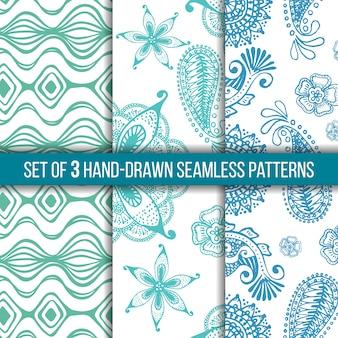 Conjunto de 3 patrones indios inconsútiles dibujados a mano sobre un fondo blanco, garabatos.