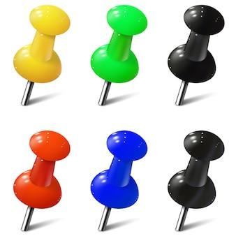 Conjunto de alfileres realistas en diferentes colores. chinchetas