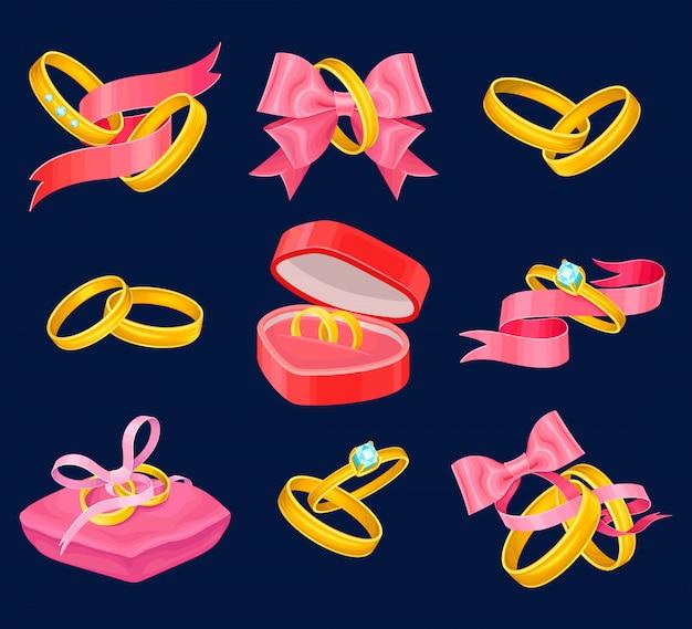Conjunto de anillos de boda y compromiso de oro. objetos aislados con cintas de color rosa, caja en forma de corazón, almohadas y lazos.
