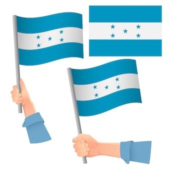 Conjunto de bandera de honduras en la mano