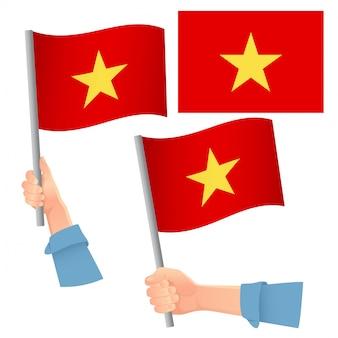 Conjunto de bandera de vietnam en mano
