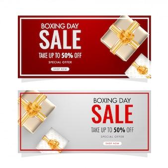 Conjunto de banner de venta de boxing day con oferta de 50% de descuento y vista superior de cajas de regalo decoradas en