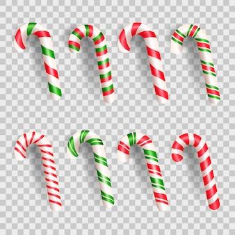 Conjunto de bastón de caramelo de navidad realista. dulces y piruletas a rayas aisladas sobre fondo blanco.