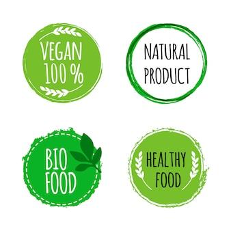 Conjunto de bio, etiquetas de alimentos saludables dibujados a mano.