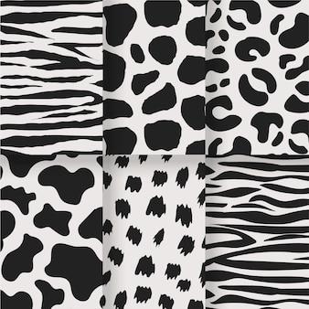 Conjunto blanco y negro de estampados sin costuras de animales.
