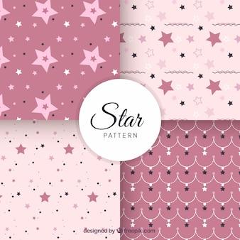Conjunto blanco y rosa de patrones de estrellas