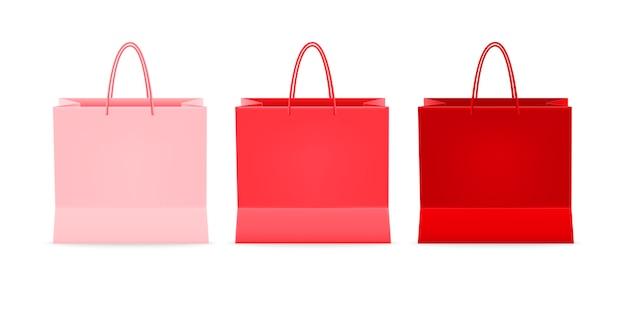 Conjunto de bolsas de plástico o papel con asas sobre fondo blanco.