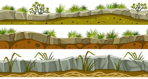 Conjunto de bordes de roca gris y hierba con suelo.