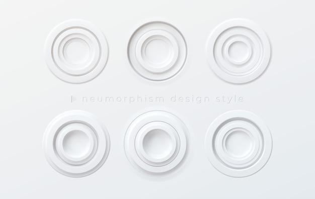 Un conjunto de botones redondos volumétricos blancos en el estilo del nuevo morfismo aislado en un fondo blanco