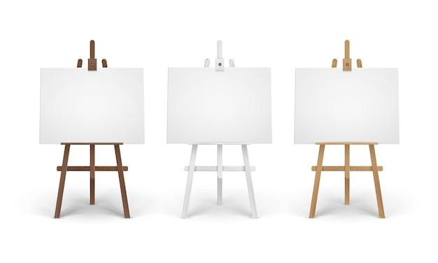 Conjunto de caballetes de madera de siena marrón blanco con lienzos horizontales en blanco vacíos