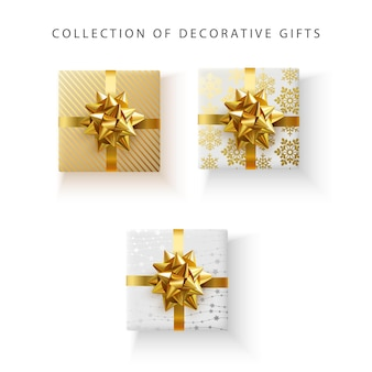 Conjunto de cajas de regalo decorativas con lazo de satén dorado aislado sobre fondo blanco.