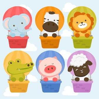 Conjunto de carácter animal con elefantes, cebras, leones, cocodrilos, cerdos y ovejas en un globo.