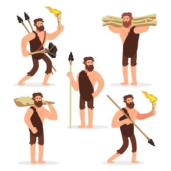 Conjunto de caracteres de dibujos animados hombres primitivos de la edad de piedra