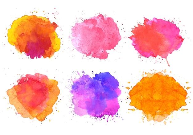 Conjunto colorido de manchas de salpicaduras de acuarela abstracta