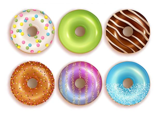 Conjunto de coloridos donuts realistas.
