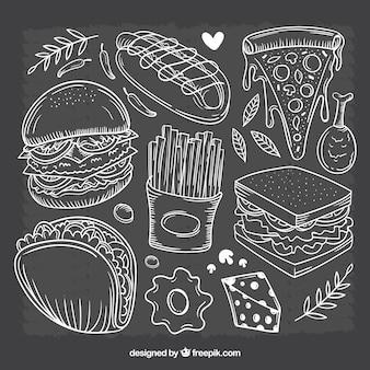 Conjunto de comida dibujada a mano en pizarra