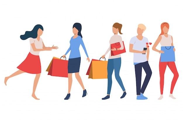 Conjunto de compradores. mujeres sosteniendo bolsas de compras