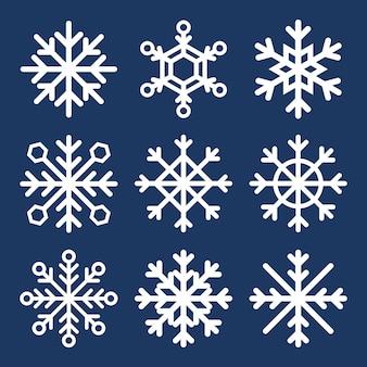 Conjunto de copos de nieve en azul oscuro