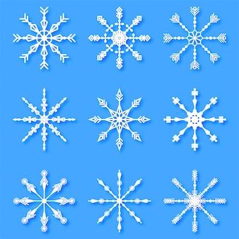 Conjunto de copos de nieve decorativos creativos de feliz navidad