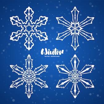 Conjunto de copos de nieve dibujados a mano