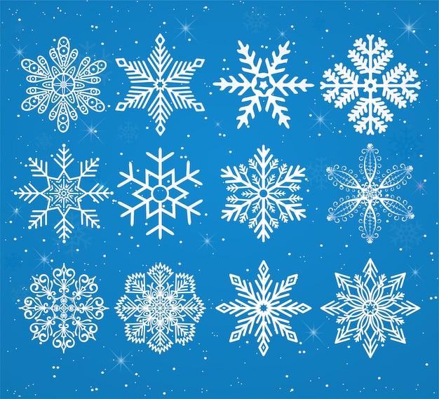 Conjunto de copos de nieve sobre un fondo nevado con estrellas