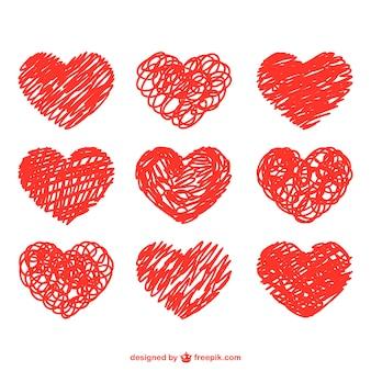 Conjunto de corazones dibujados con garabatos