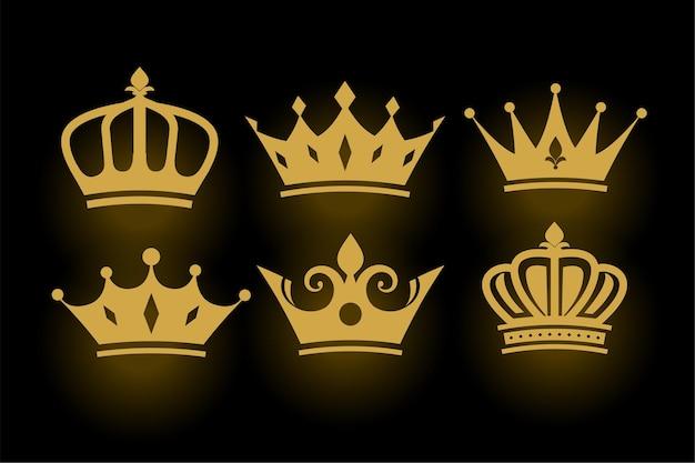 Conjunto de coronas de rey y reina decorativas doradas.