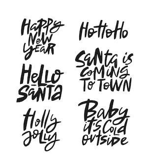 Conjunto de cotizaciones de letras de pincel de vector de año nuevo y navidad.