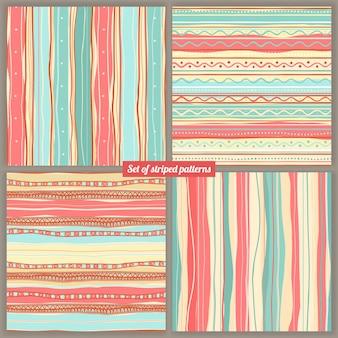 Conjunto de cuatro fondos de colores rayados