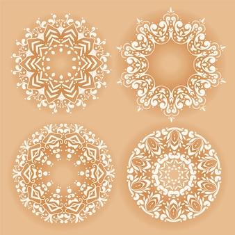 Conjunto de cuatro patrones decorativos de mandala