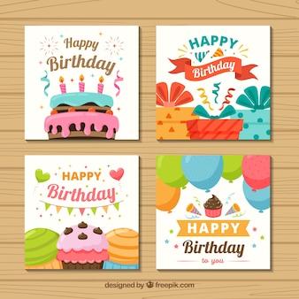 Conjunto de cuatro tarjetas de cumpleaños coloridas en diseño plano