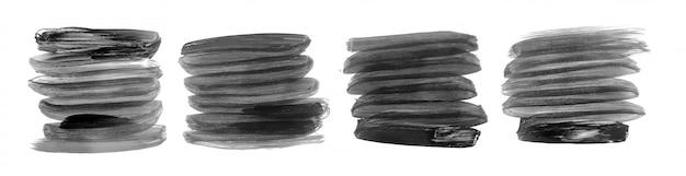 Conjunto de cuatro trazos de pincel pintados a mano en negro y gris