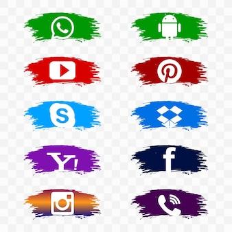 Conjunto de iconos de redes sociales sobre pinceladas de acuarela