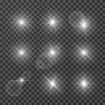 Conjunto de destellos brillantes de luz blanca