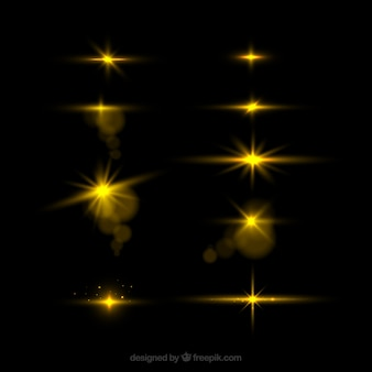 Conjunto de destellos dorados con estilo realista