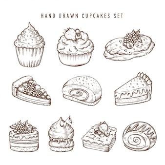 Conjunto dibujado a mano de cupcakes y productos de panadería