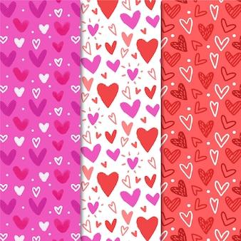 Conjunto dibujado a mano de patrones de corazón lindo