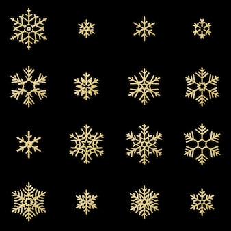 Conjunto de dieciséis copos de nieve de oro brillo alivio sobre fondo negro. año nuevo y tarjeta de navidad objeto de decoración brillante.
